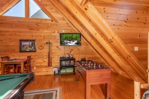 Foosball table in the game loft at Bears Eye View, a 2-bedroom cabin rental located in Pigeon Forge