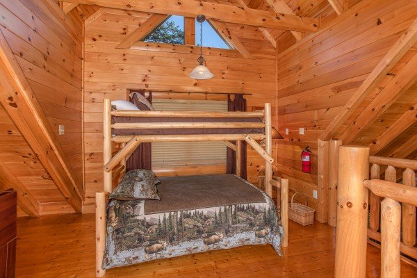 Bunk bed in the game room at Bears Eye View, a 2-bedroom cabin rental located in Pigeon Forge