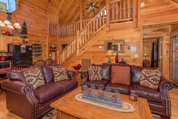 Living room couch and loveseat seating at Bears Eye View, a 2-bedroom cabin rental located in Pigeon Forge