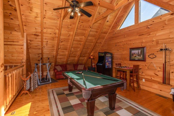Green felted pool table in the loft at Bears Eye View, a 2-bedroom cabin rental located in Pigeon Forge