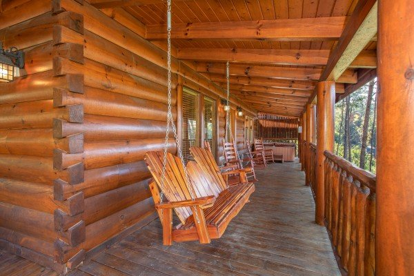 Porch swing on a covered deck at Bears Eye View, a 2-bedroom cabin rental located in Pigeon Forge