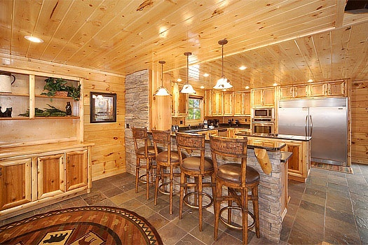 breakfast bar in the kitchen at incredible! a 6 bedroom cabin rental located in gatlinburg