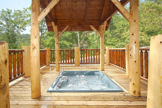 deck level covered hot tub at incredible! a 6 bedroom cabin rental located in gatlinburg