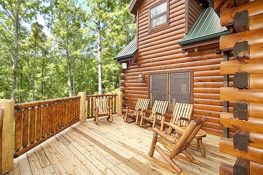 seating on the deck at incredible! a 6 bedroom cabin rental located in gatlinburg