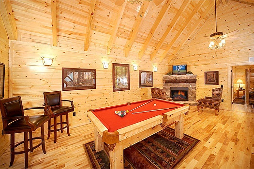 red felted pool table in lofted game room at incredible! a 6 bedroom cabin rental located in gatlinburg