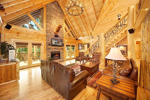 living room with cathedral ceilings at incredible! a 6 bedroom cabin rental located in gatlinburg