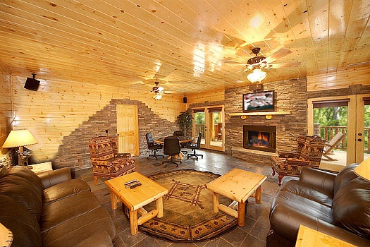 second living room on the first floor of incredible! a 6 bedroom cabin rental located in gatlinburg