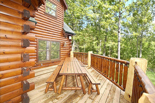 two picnic tables on the deck at incredible! a 6 bedroom cabin rental located in gatlinburg