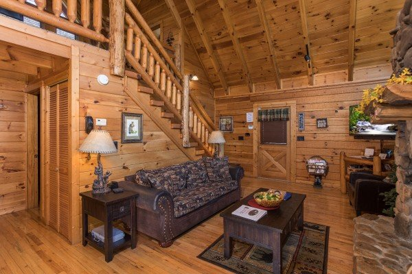 Living room with a soft, fireplace, and TV at Dancing Bearfoot, a 2-bedroom cabin rental located in Pigeon Forge