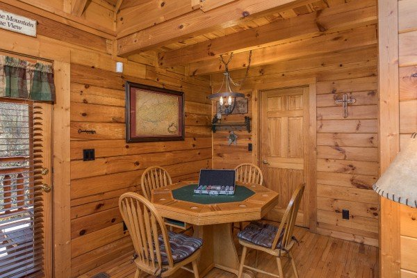 Dining table converted to a poker table at Dancing Bearfoot, a 2-bedroom cabin rental located in Pigeon Forge