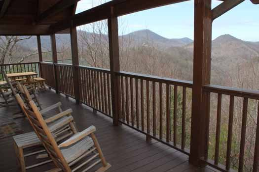 main level covered deck with rockers at smoky mountain memories a 2 bedroom cabin rental located in pigeon forge