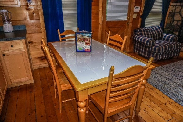 dining table for four at just you and me baby a 1 bedroom cabin rental located in gatlinburg