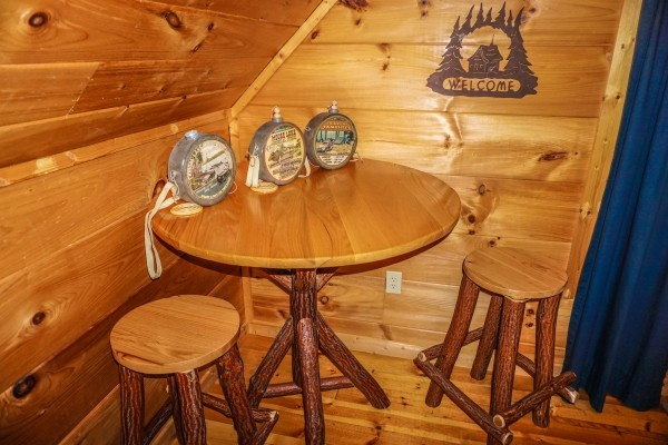 lofted game room seating and table at just you and me baby a 1 bedroom cabin rental located in gatlinburg
