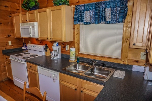 Kitchen at Just You and Me Baby, a 1 bedroom cabin rental located in Gatlinburg