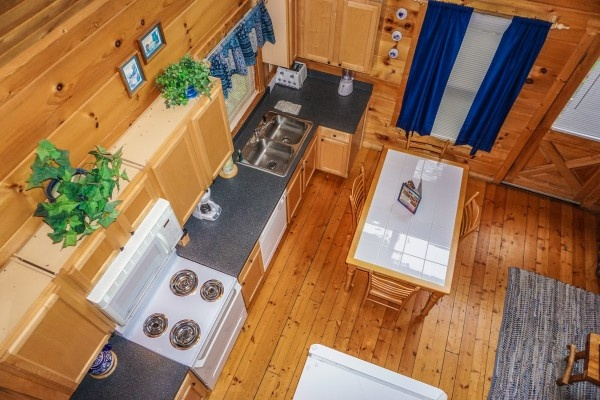 View of kitchen from above at Just You and Me Baby, a 1 bedroom cabin rental located in Gatlinburg