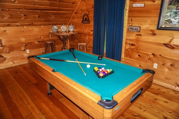 Pool table in lofted game room at Just You and Me Baby, a 1 bedroom cabin rental located in Gatlinburg