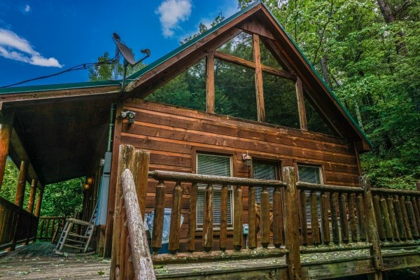 Side view of the front porch and deck at Just You and Me Baby, a 1 bedroom cabin rental located in Gatlinburg