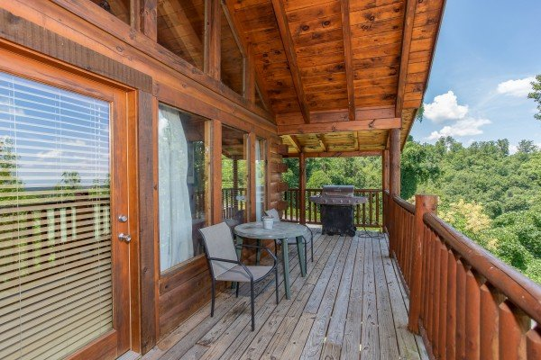 Covered deck seating for two at Majestic Sunrise, a 1 bedroom cabin rental located in Pigeon Forge