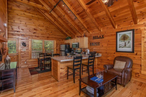 Kitchen with breakfast bar and dining space at Majestic Sunrise, a 1 bedroom cabin rental located in Pigeon Forge