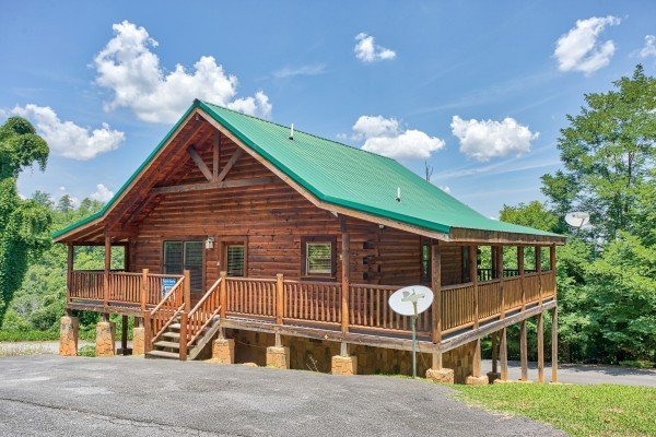 Looking at the cabin from the parking area at Majestic Sunrise, a 1 bedroom cabin rental located in Pigeon Forge