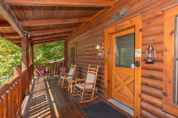 Rocking chairs on the covered front porch at Eagle Feather, a 2-bedroom cabin rental located in Pigeon Forge