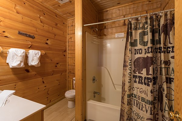 Bathroom with a tub and shower at Mountain Magic, a 1 bedroom cabin rental located in Pigeon Forge