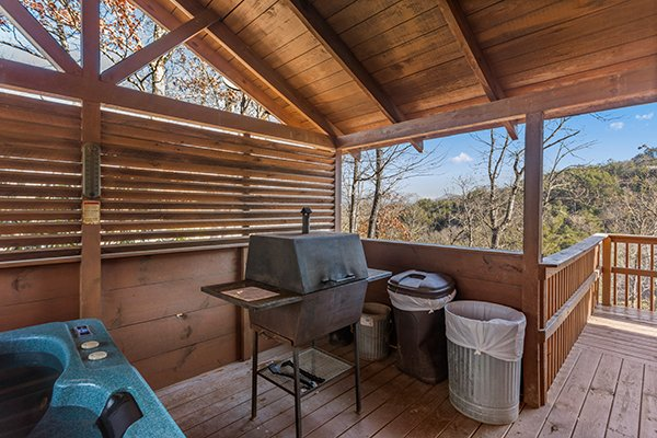 Grill on a covered deck at Mountain Magic, a 1 bedroom cabin rental located in Pigeon Forge