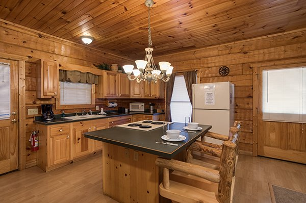 Counter top dining space for two at Mountain Magic, a 1 bedroom cabin rental located in Pigeon Forge