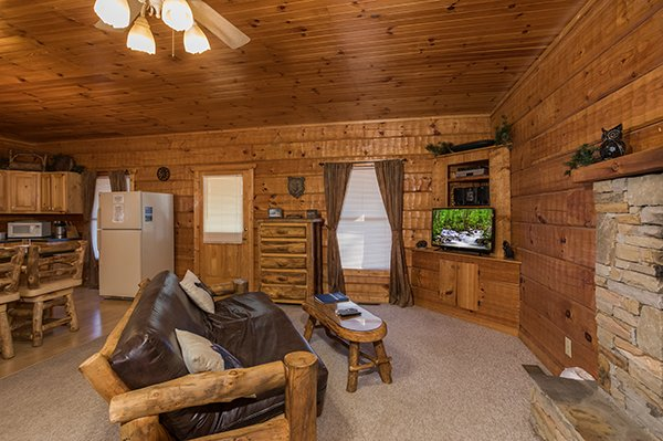 Living room at Mountain Magic, a 1 bedroom cabin rental located in Pigeon Forge