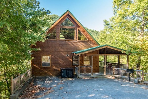 Cabin exterior and flat paved parking pad at Alone Time, a 1 bedroom cabin rental located in Pigeon Forge