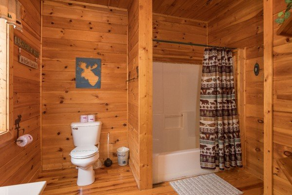 Bathroom with a tub and shower at Alone Time, a 1 bedroom cabin rental located in Pigeon Forge