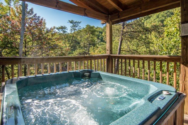 Close up view of \hot tub on covered deck at Alone Time, a 1 bedroom cabin rental located in Pigeon Forge