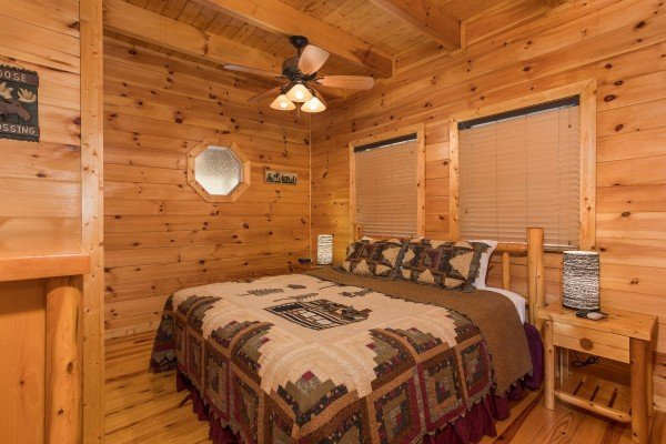 King sized log bed at Alone Time, a 1 bedroom cabin rental located in Pigeon Forge