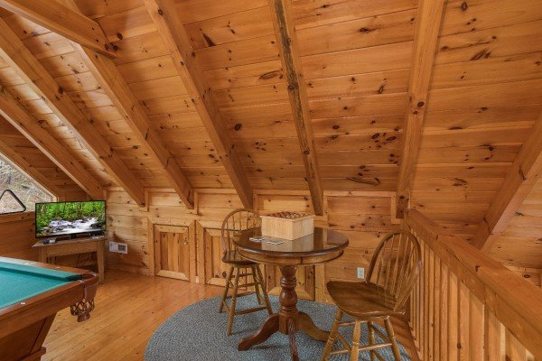 Table with seating for two in the loft at Alone Time, a 1 bedroom cabin rental located in Pigeon Forge