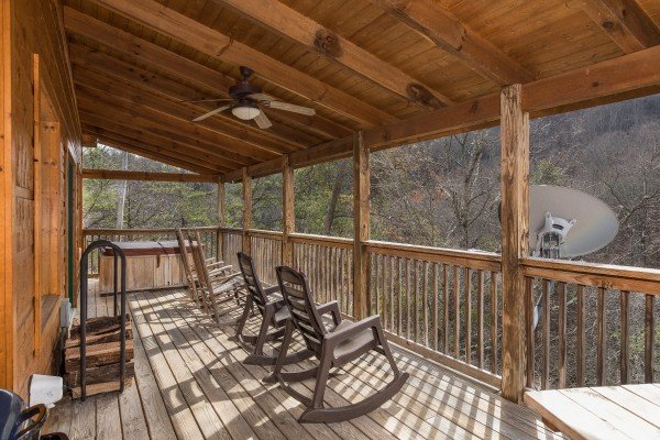 Rocking chairs on a covered deck overlooking mountains at Alone Time, a 1 bedroom cabin rental located in Pigeon Forge