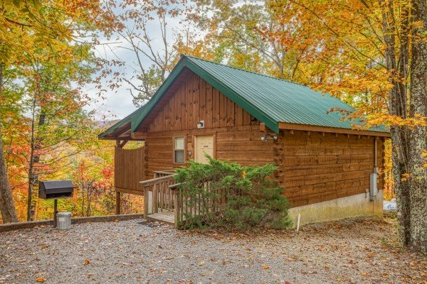 Cabin exterior and flat parking at Love Me Tender, a 1 bedroom cabin rental located in Pigeon Forge