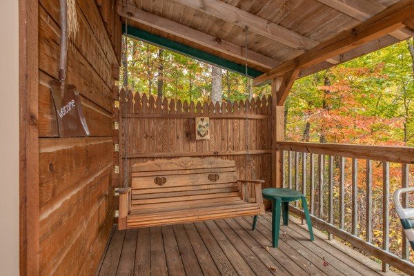 Covered porch with swing at Love Me Tender, a 1 bedroom cabin rental located in Pigeon Forge