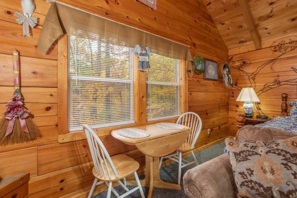 Dining table for two at Love Me Tender, a 1 bedroom cabin rental located in Pigeon Forge