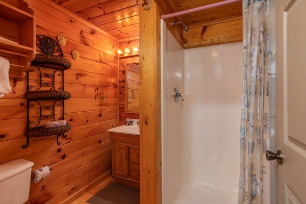 Bathroom with a walk in shower at Forever Yours, a 1-bedroom cabin rental located in Pigeon Forge