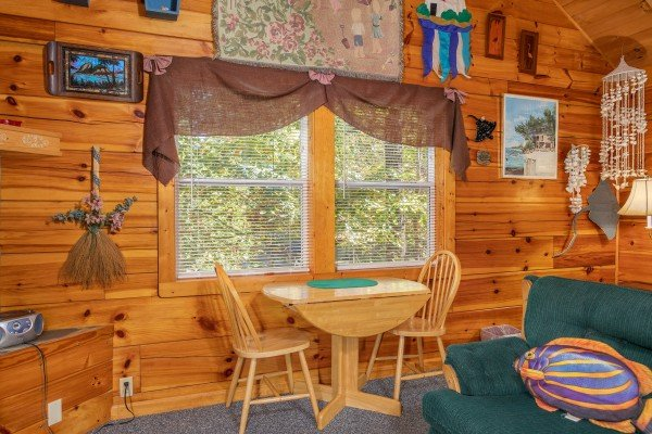 Dining table for two in the studio space at Forever Yours, a 1-bedroom cabin rental located in Pigeon Forge