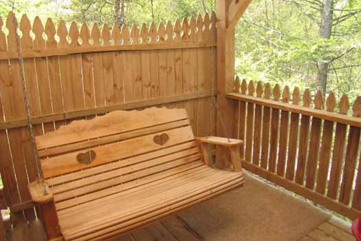 Swing on the deck at Forever Yours, a 1-bedroom cabin rental located in Pigeon Forge
