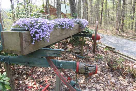 Old wagon frame in the landscape at Forever Yours, a 1-bedroom cabin rental located in Pigeon Forge