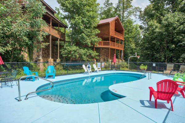 Pool and chairs for guests at Paws on the Porch, a 2 bedroom cabin rental located in Gatlinburg