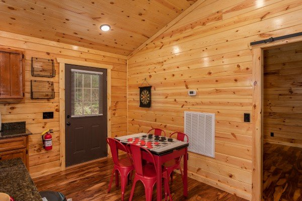 Dining table in the kitchen at Paws on the Porch, a 2 bedroom cabin rental located in Gatlinburg