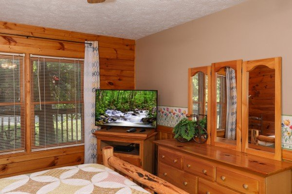 TV and dresser in a bedroom at Timber Creek, a 4 bedroom cabin rental located in Pigeon Forge