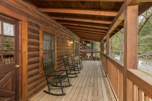 Rocking chairs on a lower deck at Timber Creek, a 4 bedroom cabin rental located in Pigeon Forge