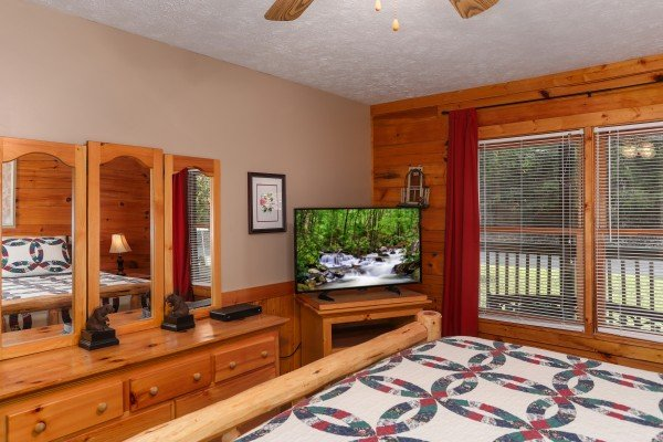 Dresser and TV in a bedroom at Timber Creek, a 4 bedroom cabin rental located in Pigeon Forge