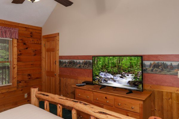 TV in a loft bedroom at Timber Creek, a 4 bedroom cabin rental located in Pigeon Forge