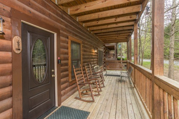 Front porch with rockers and swing at Timber Creek, a 4 bedroom cabin rental located in Pigeon Forge