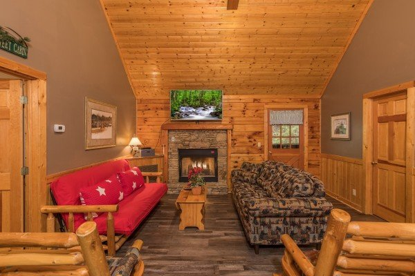 Fireplace and TV in the game room at Timber Creek, a 4 bedroom cabin rental located in Pigeon Forge